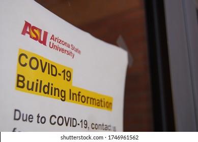 Tempe, AZ / USA - 6 1 2020: COVID 19 warning signs posted on doors entrances to Arizona State University ASU academic buildings