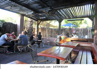 TEMPE, AZ / USA - April 28 2011: Wooden tables on the patio offer outdoor dining at Casey Moore's Oyster House at W 9th St & S Ash Ave near Arizona State University Tempe campus.