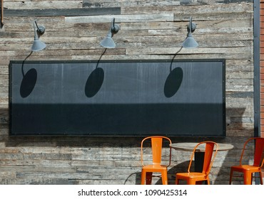 Tempe, AZ, USA: March 24, 2018: Wood wall with empty blackboard and orang echairs