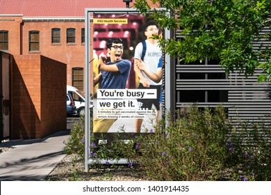 TEMPE, AZ/USA - APRIL 10, 2019: ASU Health Services sign promoting flu vaccinations on the campus of Arizona State University.