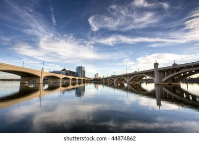 Tempe Town Lake with Mill Avenue bridges and downtown buildings.