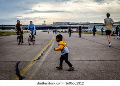 Tempelhof, Berlin, Germany, august 2019, kid playing at the Tempelhof Airport park