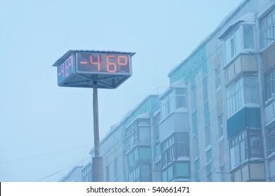 Temperature indicators on city board. Abnormally low air temperature,-46 degrees. Russia, Western Siberia.