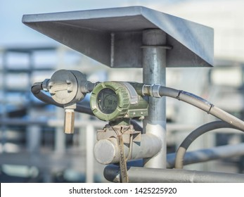 Temperature transmitter for measuring instrument close up in industry zone at power plant.