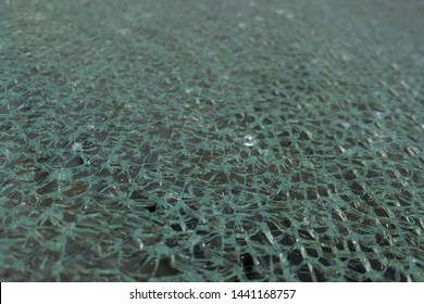 Tempered glass panels with cracks that are caused by shock and lose the strength of the glass until it is a fine grain surface.