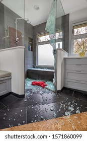Tempered glass shower door spontaneously exploded scattering glass all over the bathroom