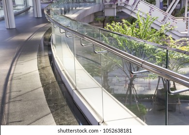 tempered glass of walk way balcony with stainless steel handrail