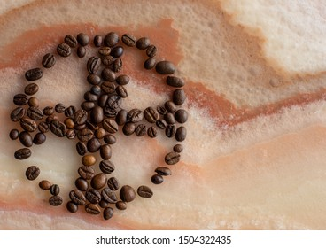 Templar cross shape, made of coffee beans on a marble background