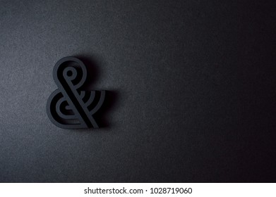 Template with black ampersand on black background for your design projects.