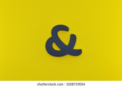 Template with black ampersand on yellow background for your design projects.