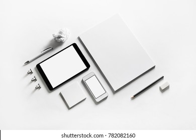 Template for branding identity. Photo of blank stationery set on paper background. Objects for placing your design.