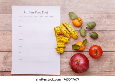 A template for a gluten free diet plan for each day of the week. Juicy fruit and a ruler is a concept of health benefits and getting rid of allergies.