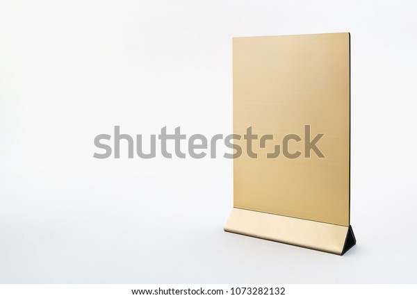 Template of golden table tent on the white background
