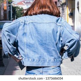 template and mockup blank blue denim jacket posing against street background, blank mockup for print store