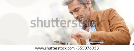 Template web, mature businessman sending message with smartphone