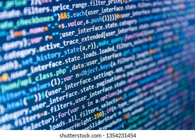 Template of website, selective focus. Web working on computer. JavaScript code in text editor.  Javascript abstract computer script, random parts of program code. IT business.