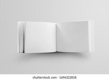 Template of a white book landscape orientation, standing and open in the middle, a standard object for the presentation of design and pattern. Mockup hardcover business catalog isolated on background