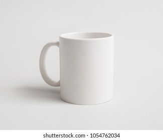 Template of a white mug on the white background