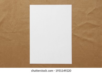 Template of white paper lies on light brown cloth background. Concept of business plan and strategy. Stock photo with empty space for text and design.