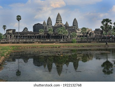 The temple of Angkor Wat, reflected in a lake,  the world's largest religious monument, near Siem Reap, Cambodia.