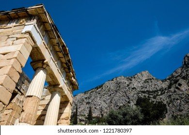 Temple of Apollo with blue sky and Stone Mountain in Delhi Greece, This temple was destroyed by earthquake in 375 BC. Greece gods, God Apollo, Greece architecture. Greek architecture, Greek gods.