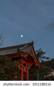 Temple buildings at dusk with the moon rising at Kiyomizudera in eastern Kyoto, Japan