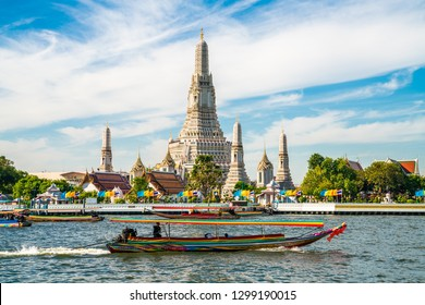 Temple of dawn Wat Arun with boat blue sky sunny day travelin Bangkok Thailand