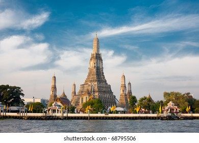The Temple of Dawn, Wat Arun, on the Chao Phraya river and a beautiful blue sky in Bangkok, Thailand. Horizontal with copy space