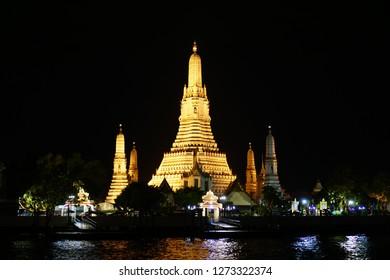 Temple of Dawn, Wat Arun Ratchawararam in Bangkok. Wat Arun is at the Chaophraya riverside. Phraprang Wat Arun is a famous landmark of Thailand.