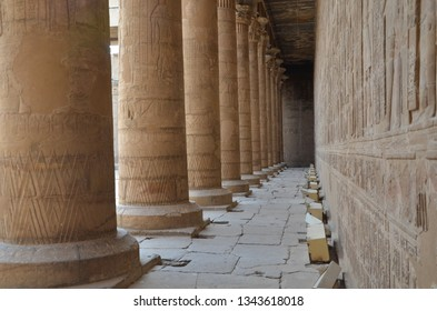 The Temple of Edfu is an Egyptian temple located on the west bank of the Nile in Edfu, Upper Egypt. It's considered to be one of the most beautiful and preserved Temples in Egypt. Corridor with pillar