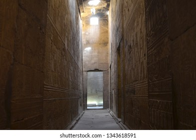 The Temple of Edfu is an Egyptian temple located on the west bank of the Nile in Edfu. It's considered to be one of the most beautiful and preserved Temples in Egypt. Beautiful passage with sunlight