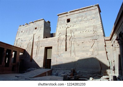 The Temple of Edfu (Idfu, Edfou, Behdet)  is an Egyptian temple located on the west bank of the Nile in Edfu, Upper Egypt. Dedicated to Horus and Hathor of Dendera