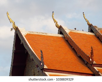 temple facade roof decorative elements detail of THAI buddhism historic temple architecture building with gold brown colour and artistic decorative hand crafted mosaic of northern THAI style ornaments