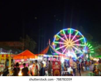 Temple fair colorful flag night party, Thai temple festival fair in blurred and de-focus