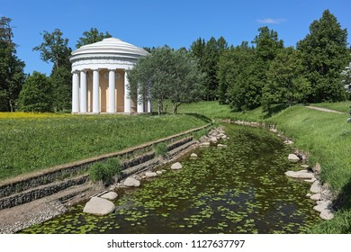 Temple of Friendship in Pavlovsk Park at a turn of the river Slavyanovka, Saint Petersburg, Russia. The temple was built in 1781-1784. Pavlovsk Park is the public park with free access.