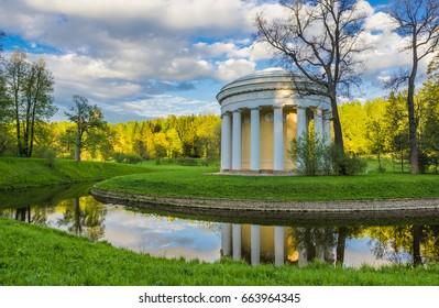 The Temple of Friendship at the Slavyanka River. Spring evening in Pavlovsk Park near Saint-Petersburg, Russia