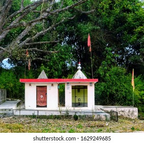 A temple with green background writeen on temple wall and on flag God is Great