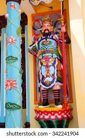 Temple guardian,  Cao Dai Temple,  Mekong River delta,  Vietnam