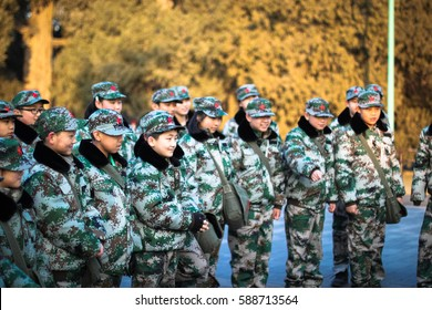 TEMPLE OF HEAVEN, BEIJING / CHINA - JANUARY 25, 2016 - A group of Chinese kids all dressed in army uniform.