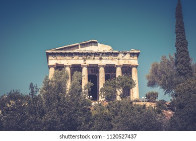 Temple of Hephaestus in Agora, Athens, Greece. It is one of the main landmarks of Athens. Beautiful view of the ancient Greek Temple of Hephaestus in summer. Scenic vintage postcard of Athens.