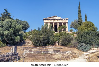 Temple of Hephaestus in Agora, Athens, Greece. It is one of the main landmarks of Athens. Beautiful panoramic view of the ancient Greek Temple of Hephaestus in summer. Scenic postcard of Athens.
