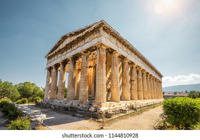 Temple of Hephaestus in Agora, Athens, Greece. It is one of the main landmarks of Athens. Sunny view of the ancient Greek Temple of Hephaestus. Famous historical architecture of Athens in sun light.