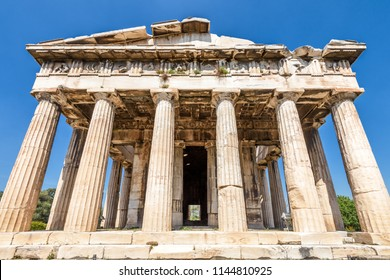 Temple of Hephaestus in Agora close-up, Athens, Greece. It is one of the main landmarks of Athens. Front view of the ancient Greek Temple of Hephaestus in summer. Historical sunny postcard of Athens.