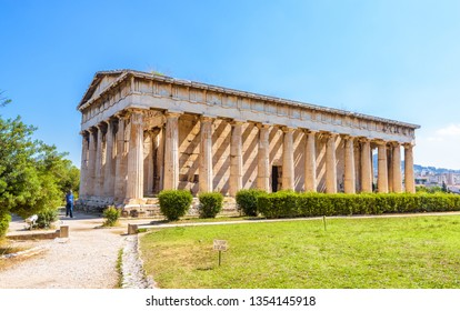 Temple of Hephaestus in Athens, Greece. It is an old famous landmark of Athens. Sunny view of Ancient Greek ruins in the Athens center. Panorama of the great monument of antique Athens in summer.