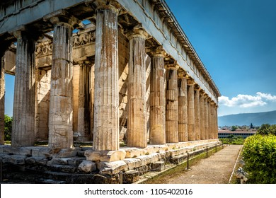 Temple of Hephaestus in Athens, Greece. It is one of the main landmarks of Athens. Sunny view of ancient Greek ruins in Athens centre. Famous historical architecture at Agora of Athens in summer.