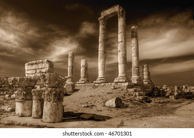 Temple of Hercules in Amman Citadel, Al-Qasr site, Jordan in sepia tone with dramatic sky