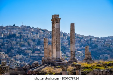 Temple of Hercules - Citadel Amman with traditional middle eastern houses in the background