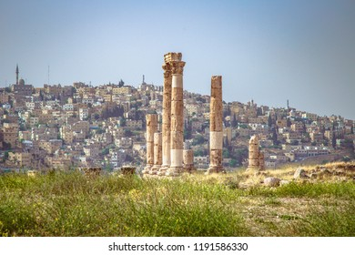 Temple of Hercules,  old citadel of  Amman with traditional middle eastern houses in the background, Jordan