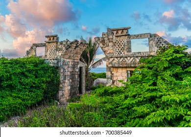 The temple of Ixchel at Beach of Isla Mujeres at sunset. Ixchel - Mayan goddess of Moon and Fertility. Isla Mujeres - beautiful island lies in 8 miles northeast of Cancun in Caribbean Sea. Mexico.