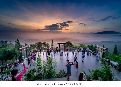 "Temple ""Linh Qui Phap An"", Bao Loc, Lam Dong province, Vietnam - Jun 2, 2019: Tourists are visiting and taking selfies at the temple ""Linh Qui Phap An"" in Bao Loc, Lam Dong province, Vietnam"